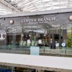 Vitrine en menuiserie aluminium pour le restaurant Copper Branch à Confluence